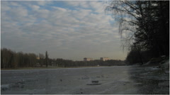 Frozen pond in the winter urban with clouds (taymlaps) Stock Footage