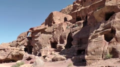 Jordan historical and archaeological city Petra 044 rock cut dwellings Stock Footage