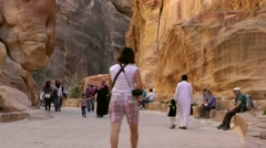 Jordan historical and archaeological city Petra 055 walkway through deep gorge Stock Footage
