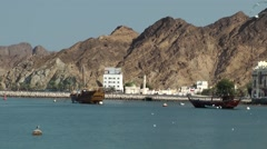 Arabia Orient Oman sultanate city of Muttrah (Matrah) 046 bay with Dau boats Stock Footage