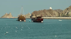 Arabia Orient Oman sultanate city of Muttrah (Matrah) 048 Dau boats and seagulls Stock Footage
