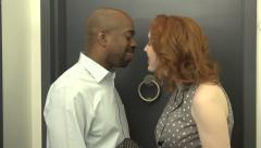 An interracial couple return from a date and kiss. Stock Footage