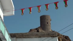 Stock Video Footage of Arabia Orient Oman sultanate city of Muttrah (Matrah) 055 tower and pennants
