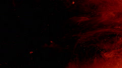 Red glowing particles and smoke floating in space, slow motion Stock Footage