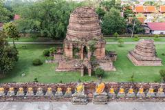 pagoda and buddha status at wat yai chaimongkol, ayutthaya, thailand - stock photo