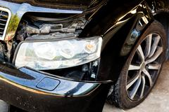 Car with body damage after an accident Stock Photos