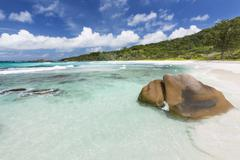 Granite boulders, white beach and turquoise water at anse cocos in la digue,  Stock Photos