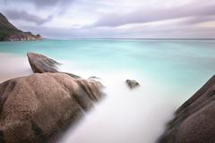 long exposure at the beach anse source d'argent in la digue, seychelles with  - stock photo