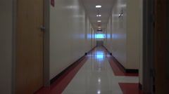 4K Light Streams Through Window Onto Hospital Hall Floor - stock footage