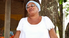 A Brazilian woman of African descent, smiling, wearing traditional clothes Stock Footage