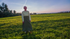 Old woman stands in front of the camera Stock Footage
