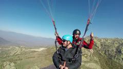 Tandem paragliding Stock Footage