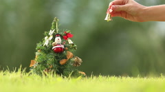 Girl rings a bell neer the Christmas tree Stock Footage