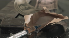 Drug syringe and cooked heroin on spoon 4K Stock Footage