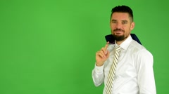 Business man smiles - (jacket over his shoulder) - green screen - studio Stock Footage