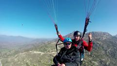 Two paragliders moves smoothly through the air Stock Footage