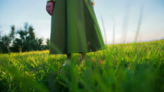 Person stand in grass at sunset low angle Stock Footage