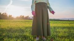 Old woman raising arms in an idyllic scene Stock Footage