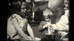 1934 kids on estate , playing yo yo Stock Footage