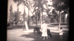 1934 kids on estate and pony, proud grandmother Stock Footage
