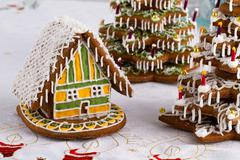 gingerbread christmas trees and gingerbread house - stock photo