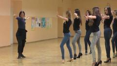 Female choreographer in dance school teaches a group of young girls Stock Footage