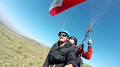 Paragliders preparation for landing Stock Footage