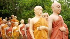 Group walking buddhas Stock Footage