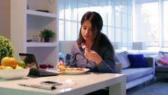 Woman eating healthy breakfast at home Stock Footage