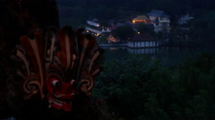 Mask hanging on a tree with the The temple of tooth in the evening Stock Footage