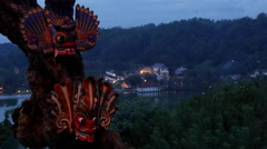 Masks at a tree with the The temple of tooth in the evening at the background Stock Footage
