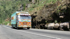 Truck driving very slow to the top of the mountain, Sri Lanka Stock Footage