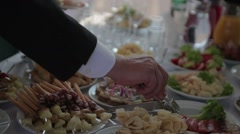People put food in a dish, Buffet Stock Footage