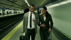 Businesspeople walking on metro station and talking, steadycam shot Stock Footage