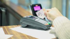 Stock Video Footage of Contactless payment - typing price on mobile terminal