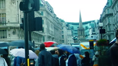 Traffic and pedestrians on All Souls Church in the background in London Stock Footage