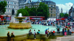 Many tourists walking in Trafalgar Square in London; time lapse - stock footage