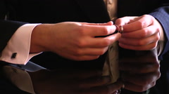 Groom fiddling with wedding rings Stock Footage
