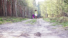Mother with a Child in the Forest Stock Footage