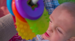 Small beautiful baby with toys Stock Footage