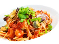 pasta with shrimps, herbs and mashrooms - stock photo
