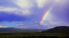 Rainbow after storm in desert - Abiquiu, New Mexico Stock Footage