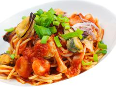 Pasta with shrimps, herbs and mashrooms Stock Photos