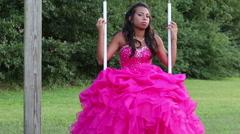 Teenage Girl in Quinceanera Dress on swing Stock Footage