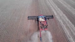 Low flight looking down on a combine harvester Stock Footage