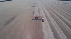 Harvester emptying into chaser bin - stock footage