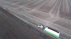 Aerial view of tractor towing a grain bin Stock Footage