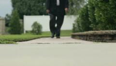 Man Walks Down Garden Path Stock Footage