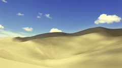 Timelapse: Clouds flowing over desert white sand dunes Stock Footage