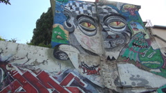 Street art painted on walls. Graffiti on a slum street wall. Stock Footage